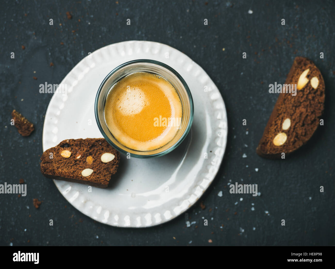 Glass of coffee espresso with chocolate and sea salt biscottii - Stock Image