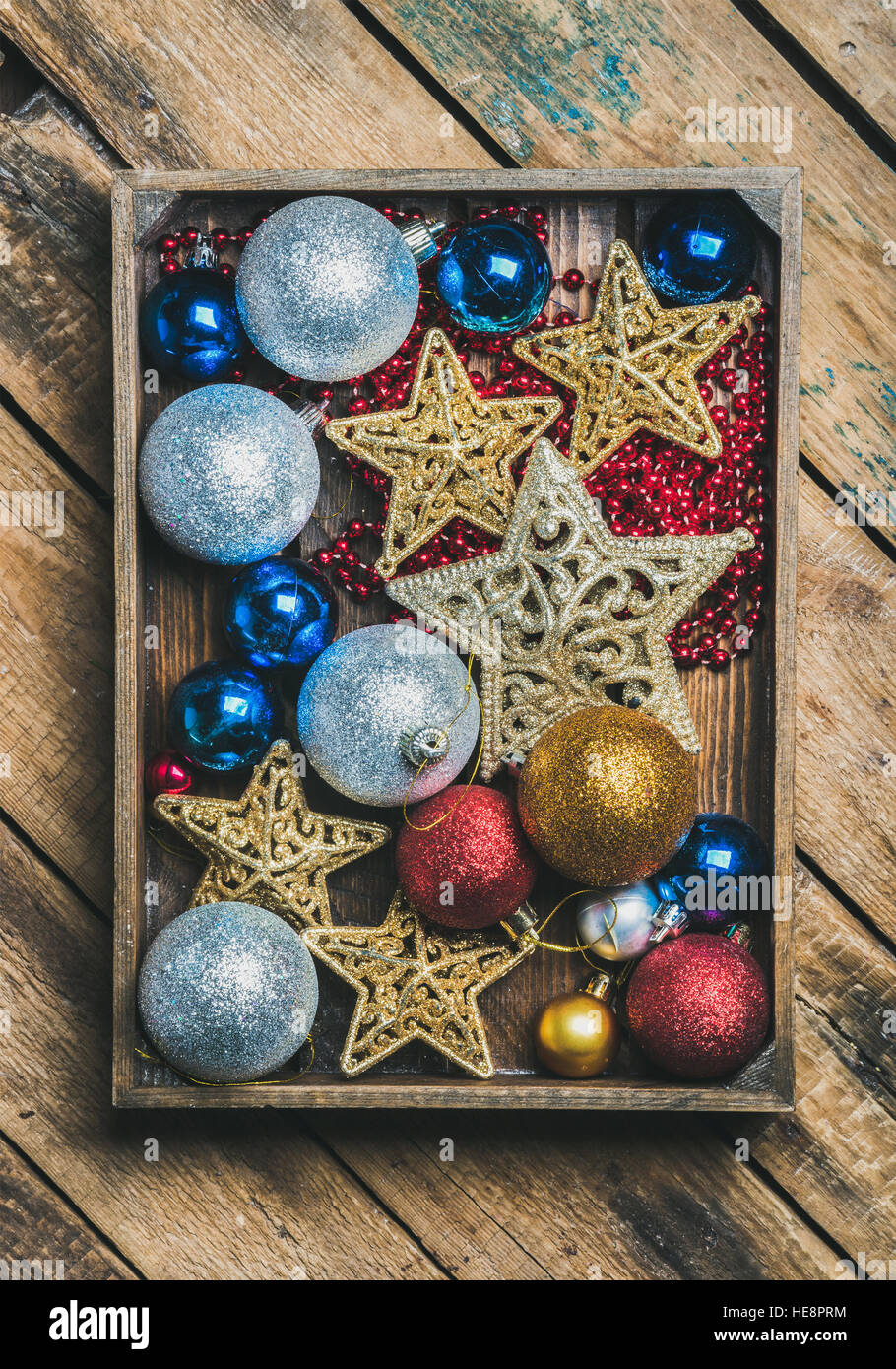 Christmas tree toy stars, balls and garland in wooden box - Stock Image