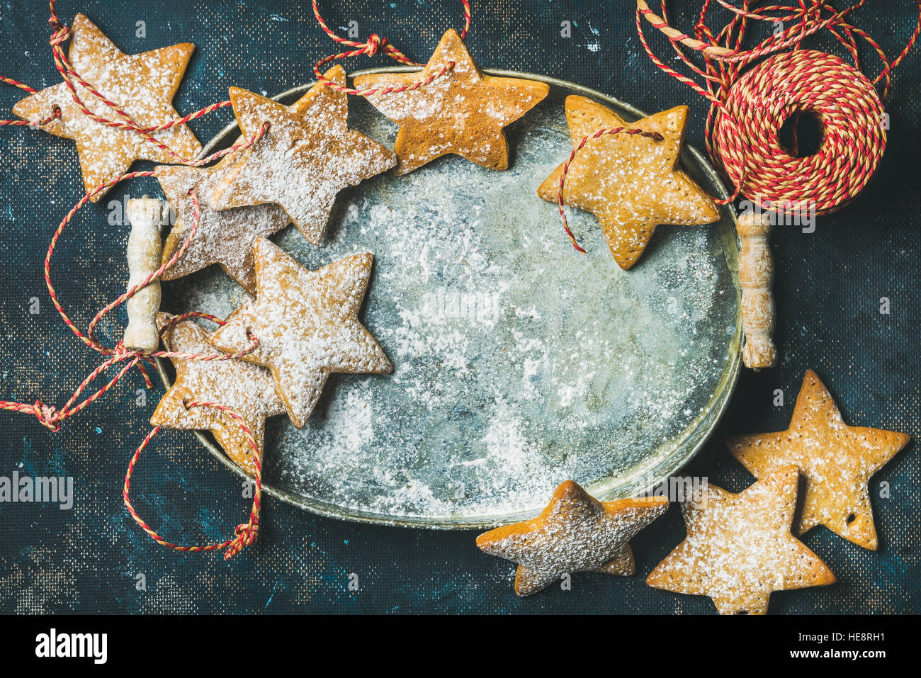 Christmas holiday star shaped gingerbread cookies in metal tray - Stock Image