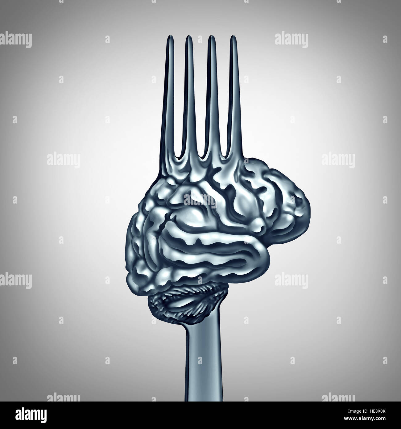Brain food symbol as a metal fork shaped as a human thinking organ to boost brainpower with nutrition concept for - Stock Image