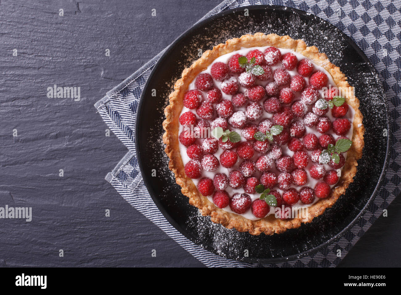 raspberry tart with cheese cream on a plate close-up horizontal view from above - Stock Image