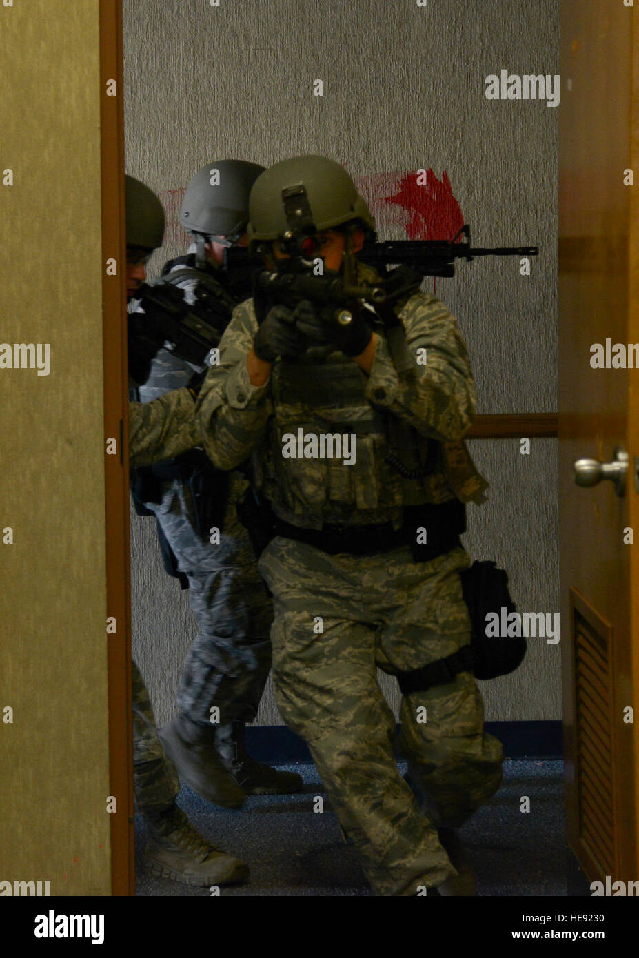Members of the 6th Security Forces Squadron emergency service team clear a building during training at MacDill Air Stock Photo