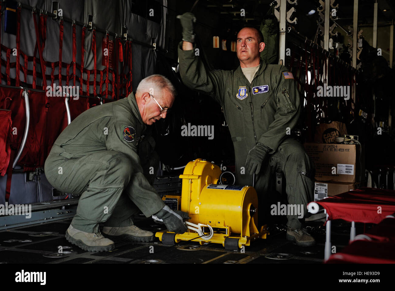 Senior Master Sgt. Dean Grothem, 934th Airlift Wing loadmaster, and Chief Master Sgt. Bill Wunderlin, 130th Rescue - Stock Image