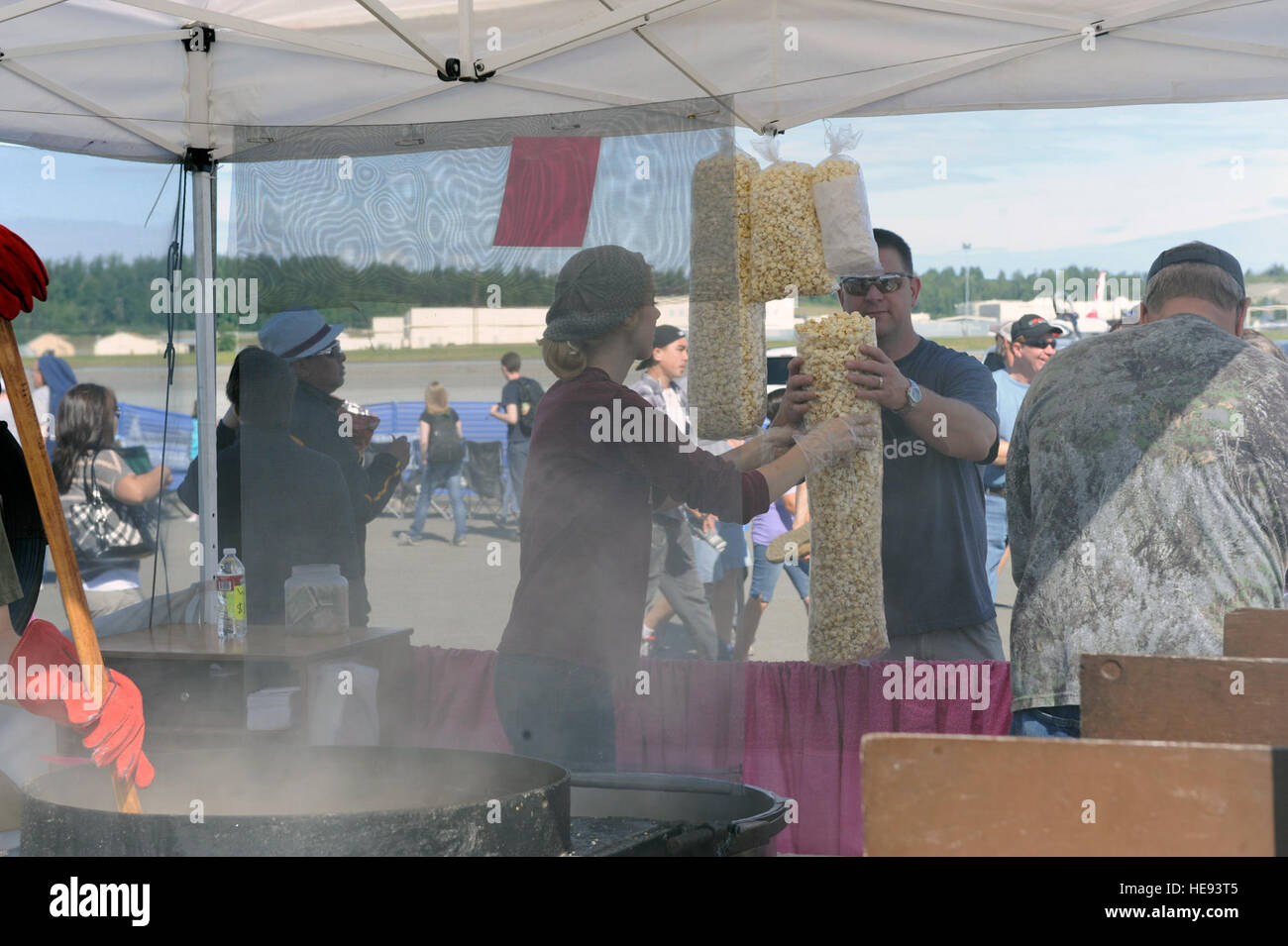 Various booths and vendors provided popcorn and other services to visitors from around Alaska attending Joint Base - Stock Image