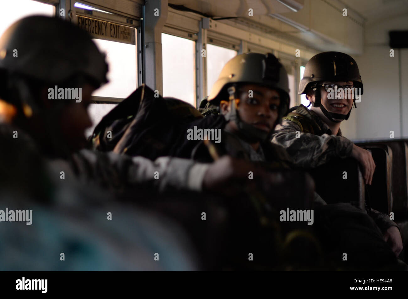 U.S. Airmen assigned to the 1st, 2nd and 3rd Combat Camera squadrons are transported to the North Auxiliary Airfield - Stock Image