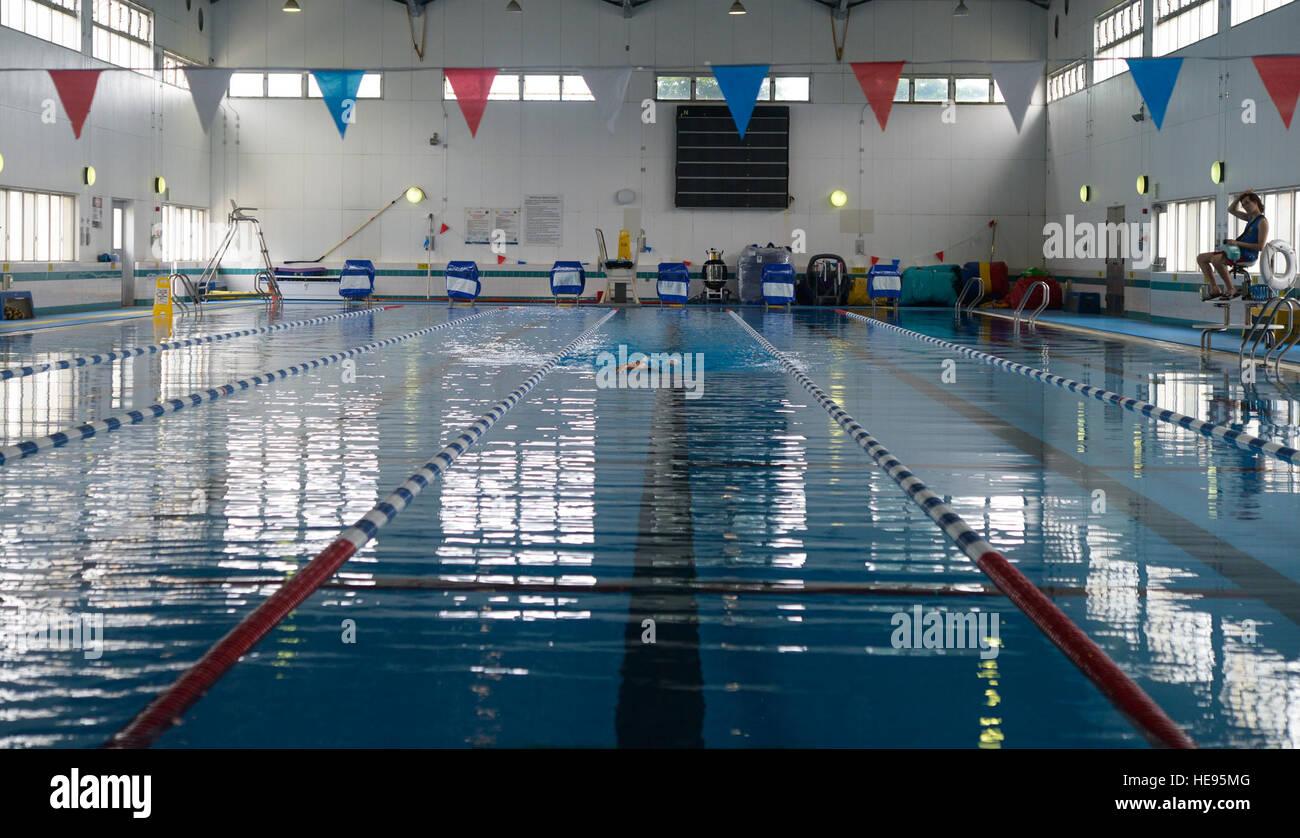 A member of Yokota Air Base, Japan, swims at the Natatorium Indoor Pool at Yokota AB, June 17, 2015. Swimming is - Stock Image