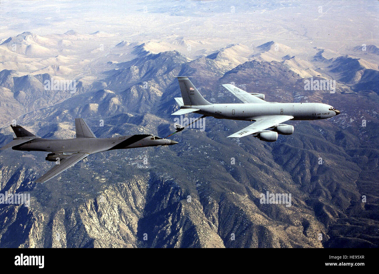 A KC-135 refuels a B-2 Aircraft while on a training mission.  The KC-135's principal mission is air refueling. - Stock Image