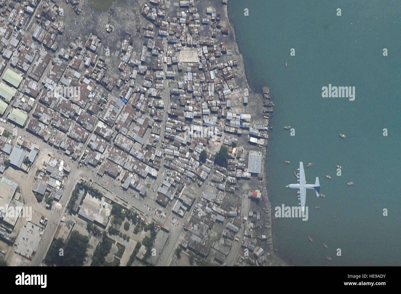 A C-130 Hercules aircraft makes a final approach into Toussaint Louverture International Airport in Port-au-Prince, - Stock Image