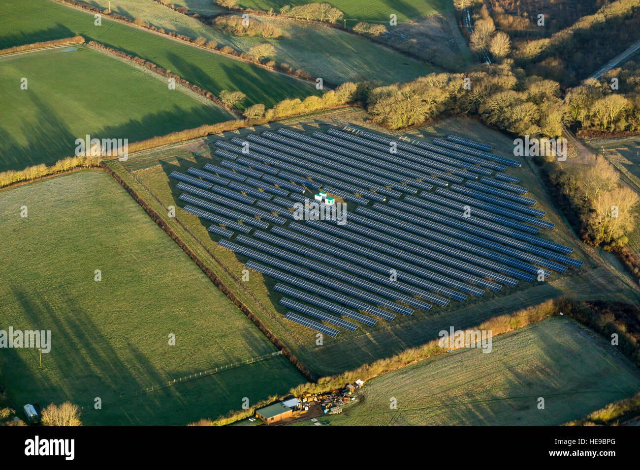 Aerial view of solar panel array, farm England - Stock Image