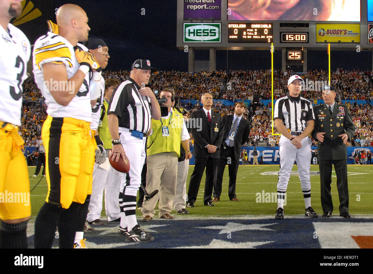 General David H. Petraeus, Commander, United Staes Central Command, talks with head Super Bowl XLIII Referee, Terry McAulay prior to the coin toss Feb. , at Raymond James Stadium in Tampa Fla.   (USAF Photo By SSgt bradley Lail) (released) Stock Photo