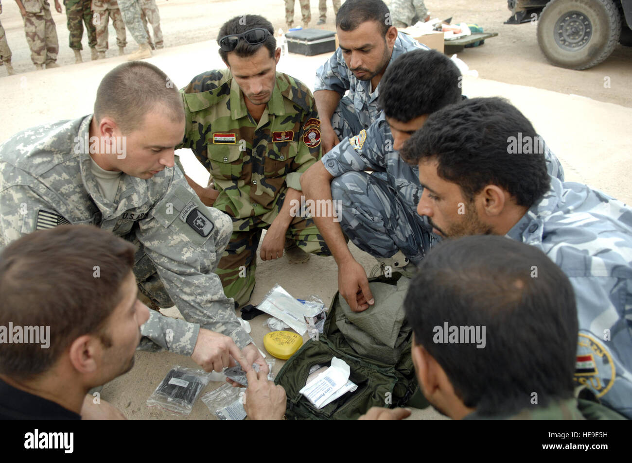 Spc. Keith Rudd, 250th Forward Surgical Team, 82d Airborne, Camp Adder, Iraq, reviews the contents of a medical - Stock Image