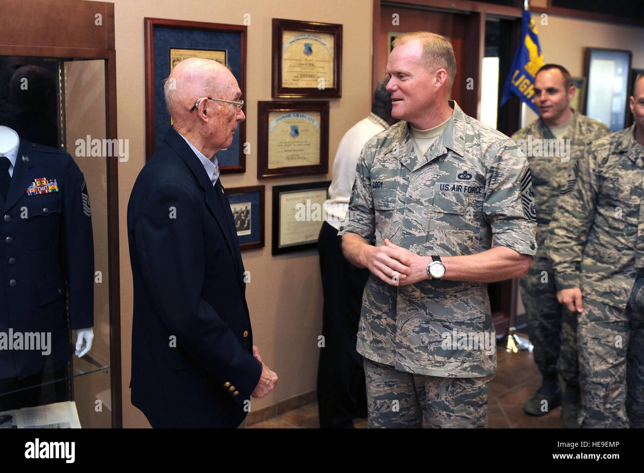 45f40db5aee Retired 6th Chief Master Sergeant of the Air Force James McCoy speaks with  the current CMSAF James Cody at the James M. McCoy Airman Leadership School  March ...