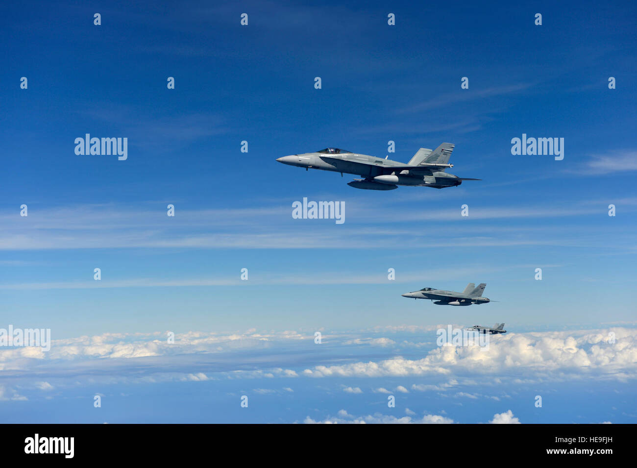 Three Royal Australian Air Force F A 18 Hornets Form Up After An
