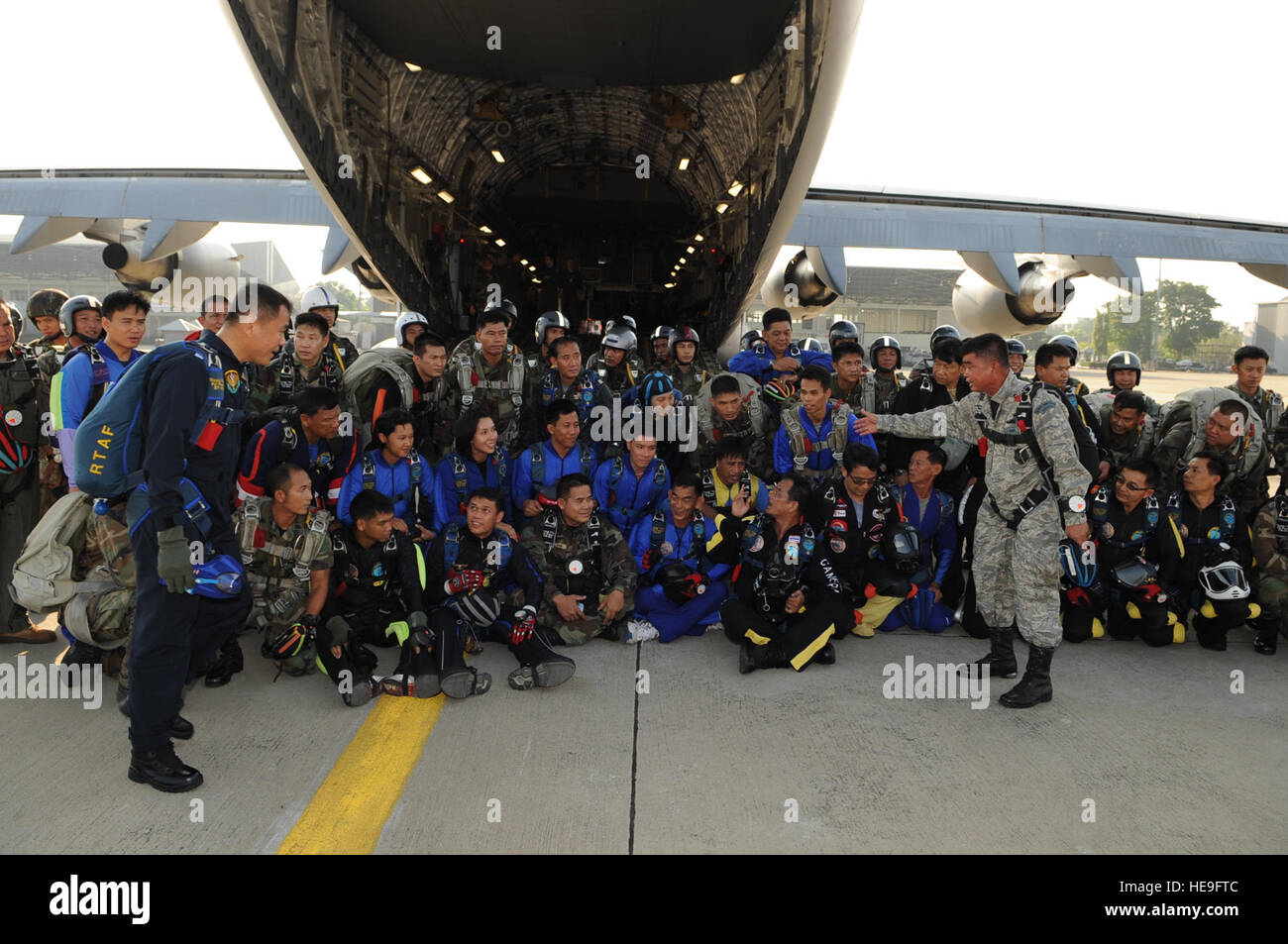 BANGKOK, Thailand  - Wing Commander Chaina Rong Pudehakarn speaks to his men of the Royal Thai Air Force Parachute Stock Photo