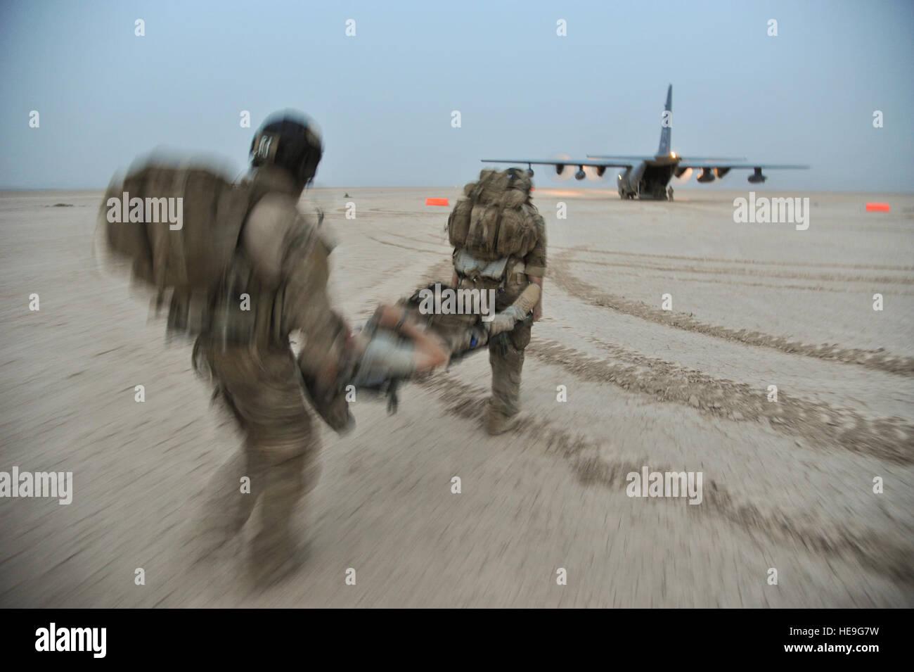 U S  Air Force pararescuemen cross-load simulated casualties