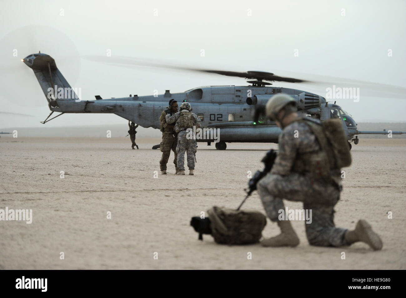 U S  Air Force pararescuemen and Army soldiers prepare to