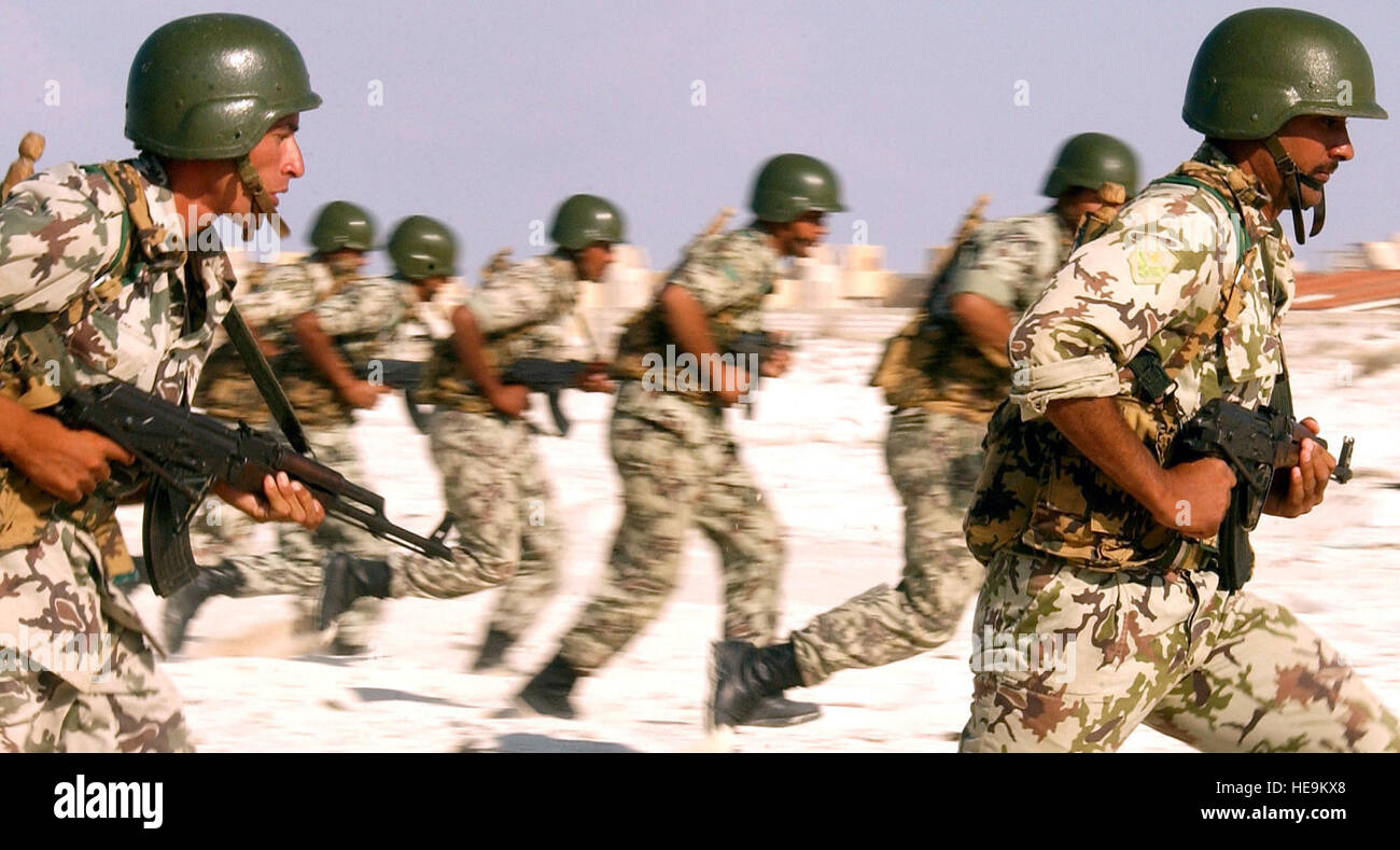 Egyptian Army Soldiers armed with 7.62mm AK-47 assault rifles practice their beach assault techniques at El Omayed, - Stock Image