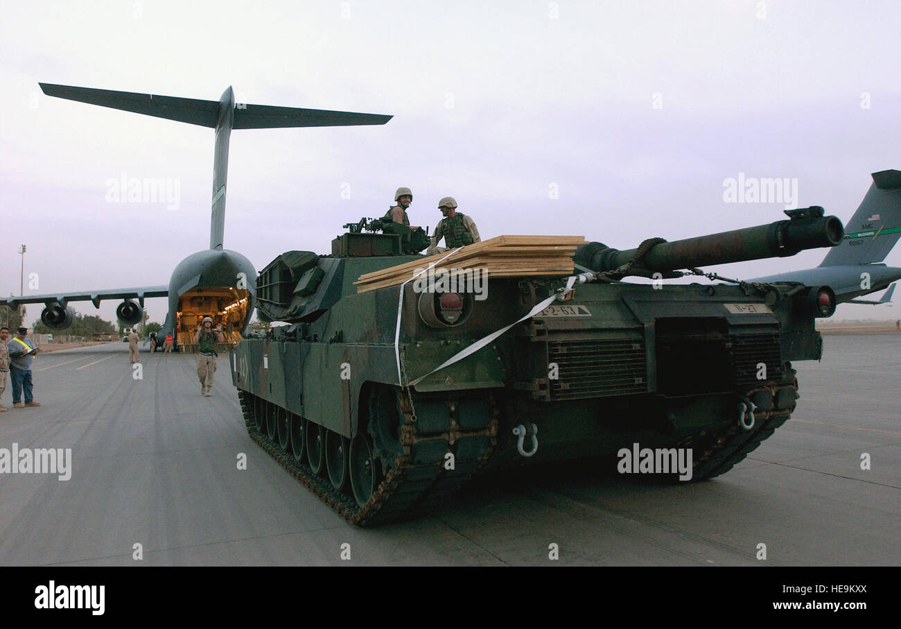 A US Army (USA) M1A1 Abrams Main Battle Tank (MBT) is marshaled away from  the aircraft 0204095d9690