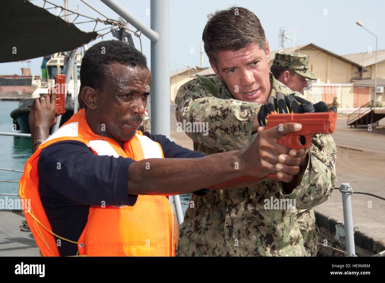 PPORT OF DJIBOUTI, Djibouti (May 28, 2012) – U.S. Navy Petty Officer 1st Class Anthony Nekervis (right), Maritime Stock Photo