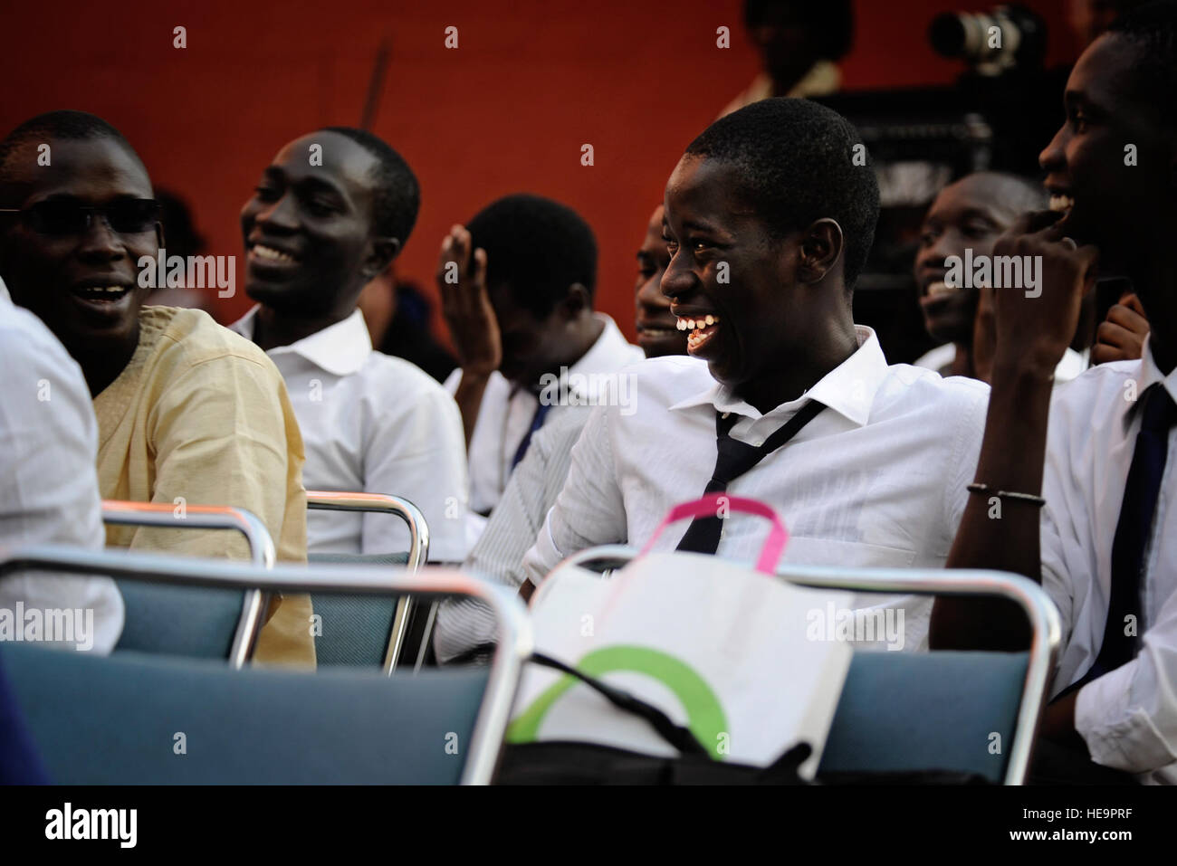 A student at a local university laughs with his friends in Dakar, Senegal, June 13, 2014, during a concert with - Stock Image