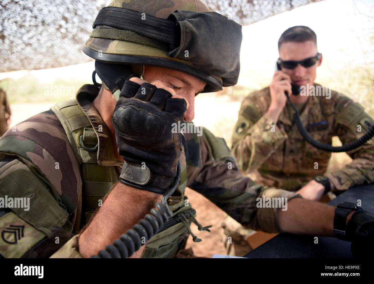 A French Army Soldier simulates calling in suspicious activity March 31, 2016, during the patrolling portion of Stock Photo