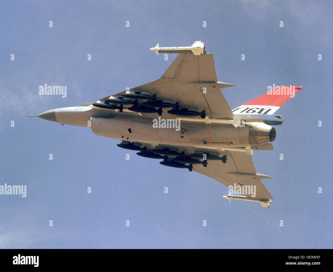 An air to air left underside view of an F-16XL aircraft.  The aircraft is armed with two wing tip mounted AIM-9 - Stock Image