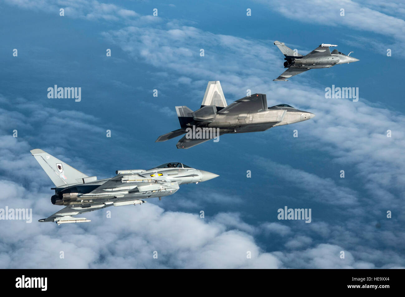 A British Royal Air Force Typhoon, U S  Air Force F-22 Raptor and