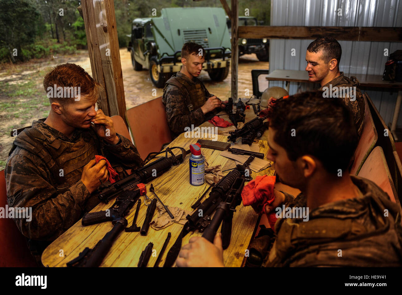 Tactical Air Control Party candidates maintain their weapons during heavy rains on Eglin Range, Fla., March 26, Stock Photo