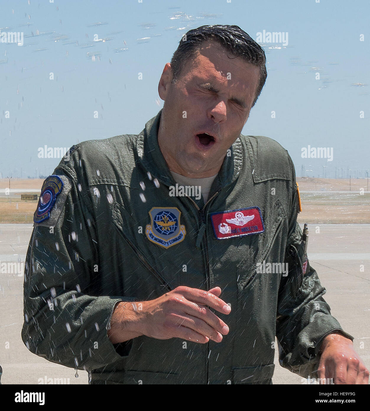 Lt. Col. Thad Middleton, 9 Air Refueling Squadron, commander, gets doused after their final fight mission at Travis - Stock Image