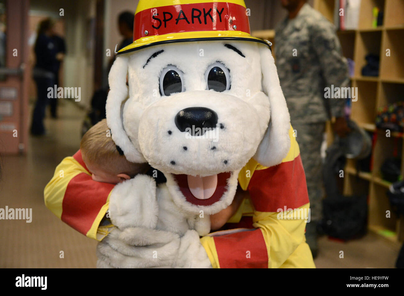 Sparky The Fire Dog Hugs A Child At Spangdahlem Air Base Germany Oct 9 2013 During Prevention Week Airman 1st Class Kyle Gese