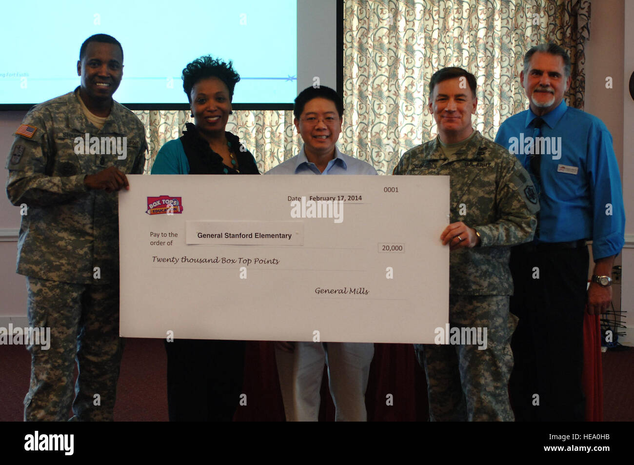 Representatives from the General Mills Box Tops for Education program present a check to General Stafford elementary - Stock Image