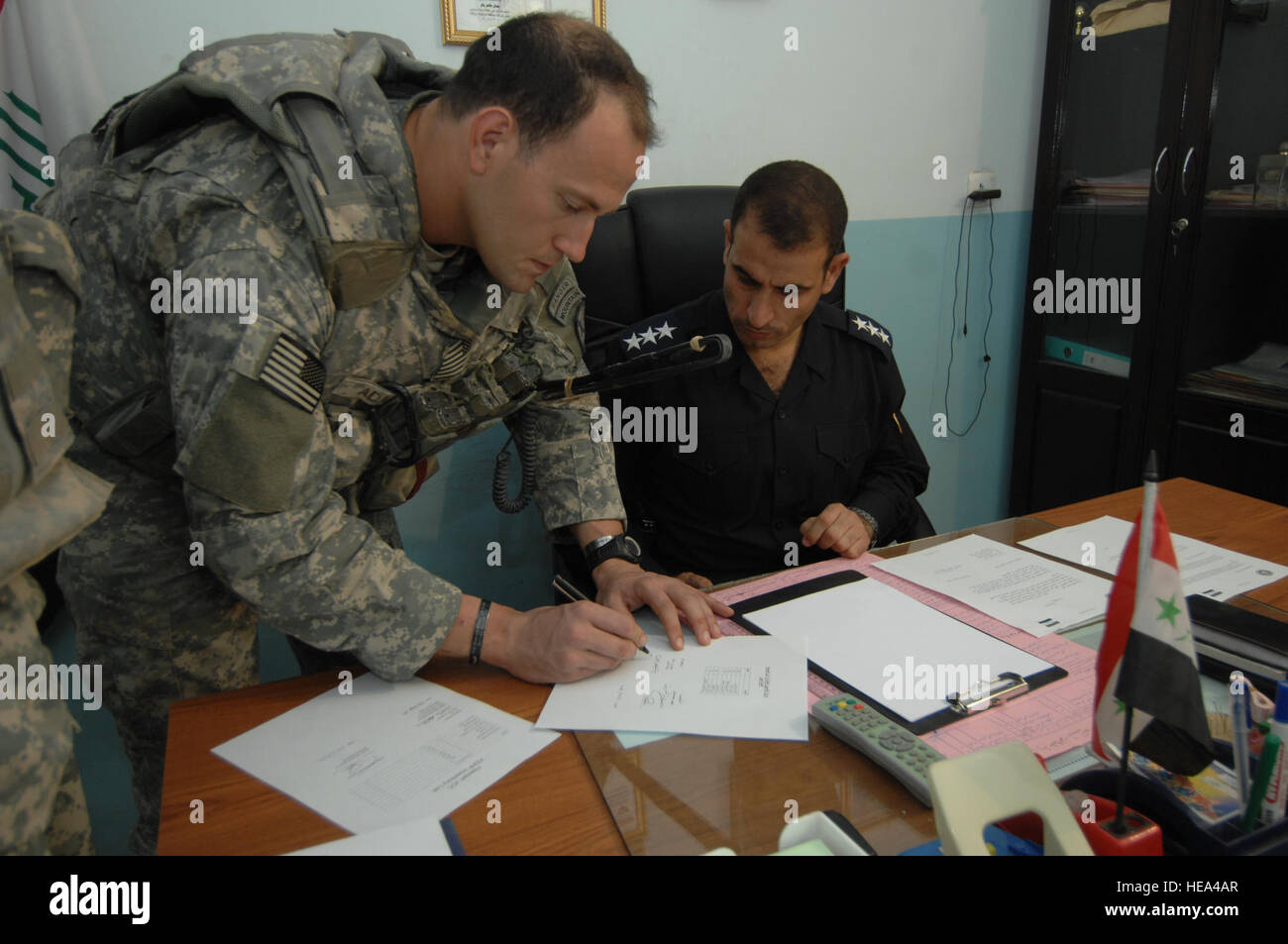 The signing of papers, finalizing the Joint Coordination Center handover from Alpha Company, 1st Battalion, 87th - Stock Image