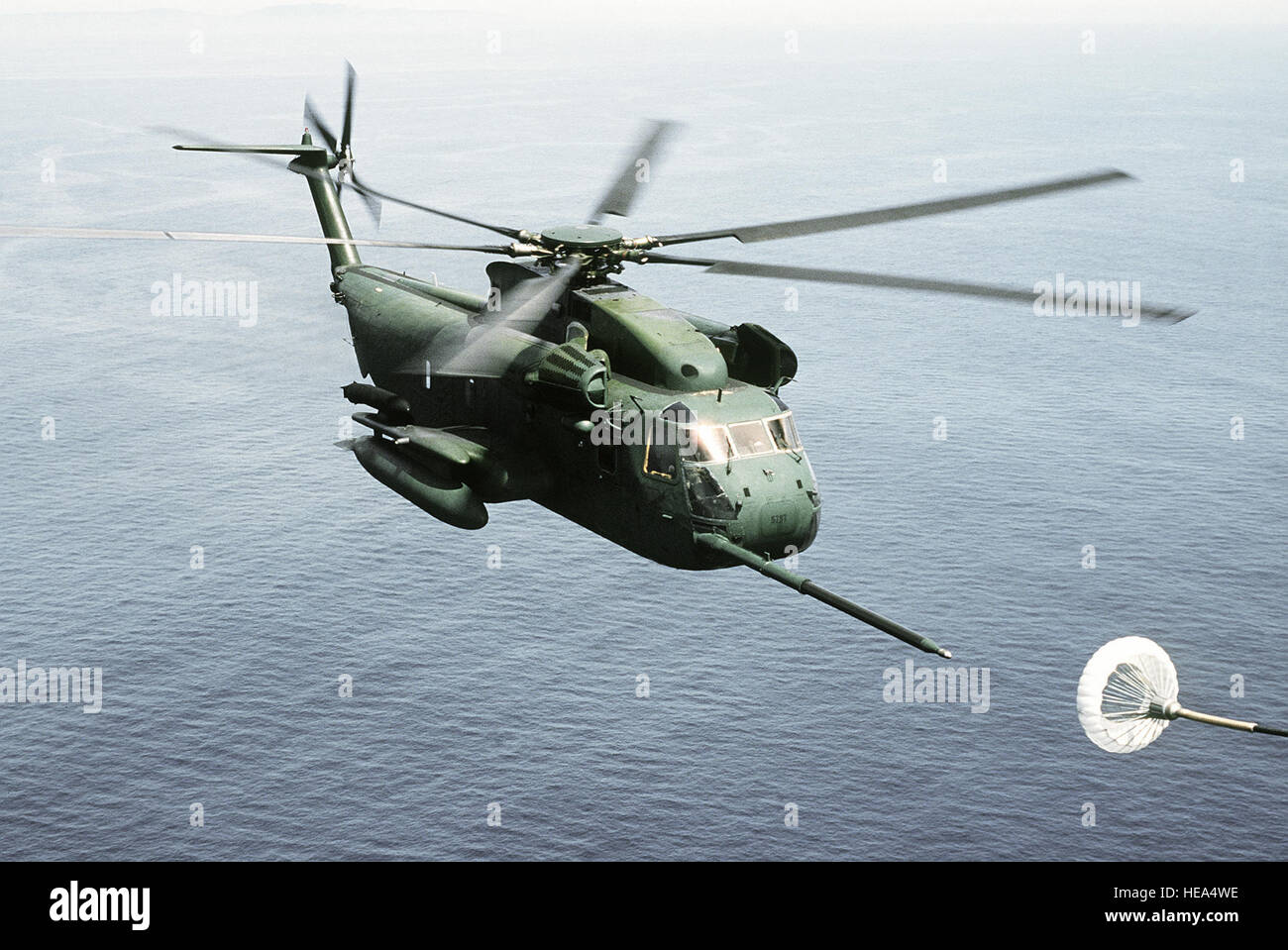 An air-to-air right front view of an HH-53C Jolly Green Giant helicopter assigned to the 67th Aerospace Rescue and - Stock Image
