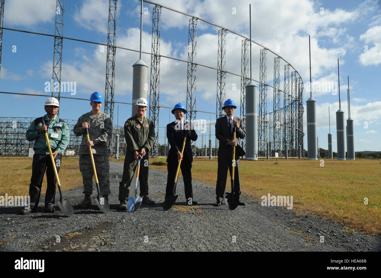 Misawa Air Base leadership and Misawa City officials take part in a ground-breaking ceremony, signifying the start - Stock Image