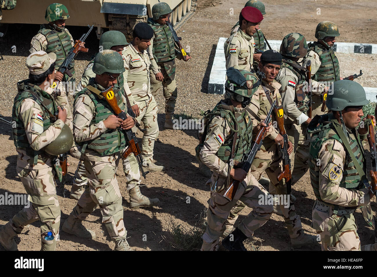 Iraqi army soldiers march en route to conduct tactical