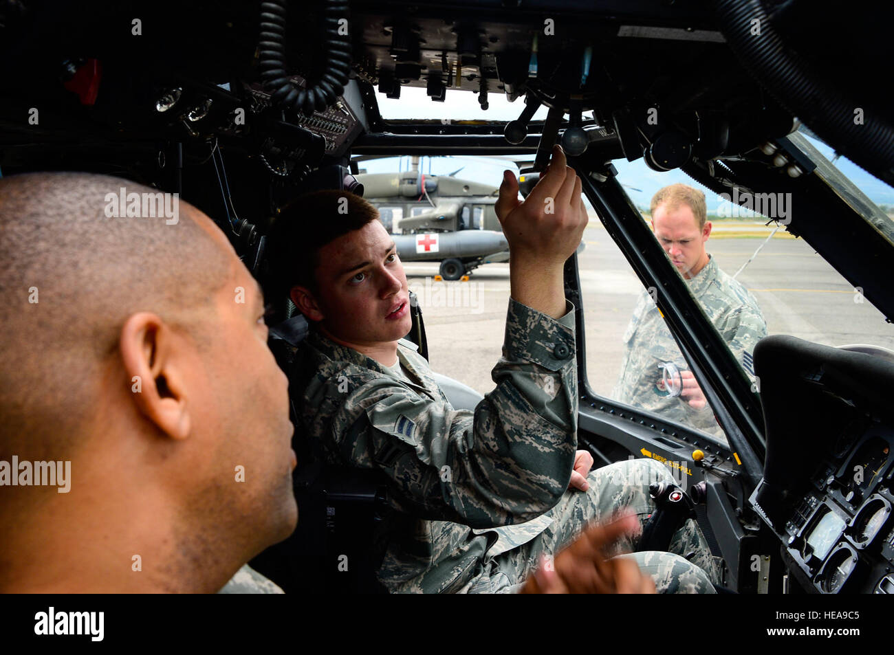 U.S. Air Force Airman 1st Class Andrew Divine, 612th Air Base Squadron firefighter, reviews the proper procedures Stock Photo