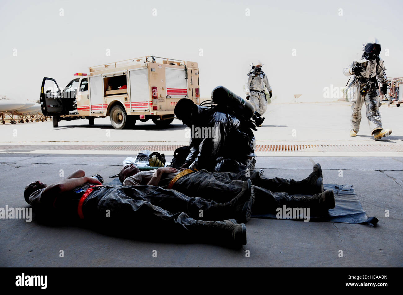 332nd Expeditionary Civil Engineer Squadron Fire Department firefighters perform initial medical treatment on two - Stock Image