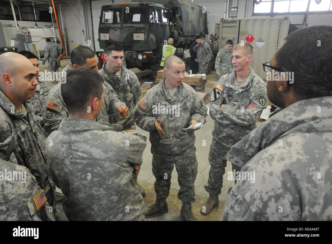 Army Sgt. Joseph Beasley, a native of Anaconda, Mont., a jumpmaster, addresses fellow soldiers assigned to the 4th Stock Photo
