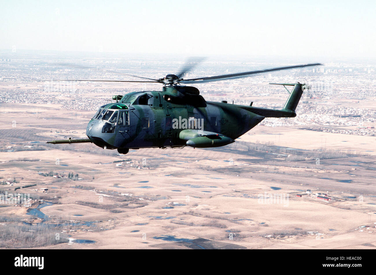 A 71st Air Rescue Squadron (71st ARS) HH-3E Jolly Green Giant helicopter flies over Canada en route to Aircraft - Stock Image