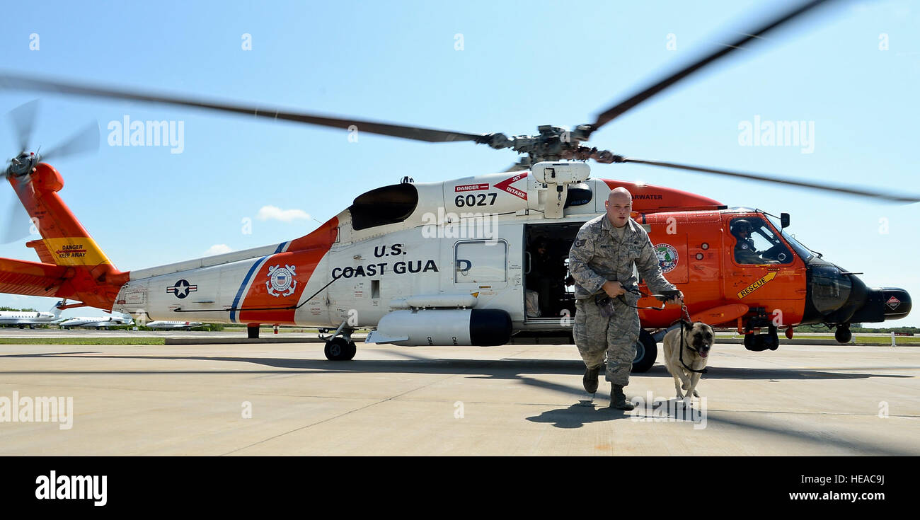 Staff Sgt. Josh Burnett, 6th Security Forces Squadron military working dog handler, and MWD Jecky vacate the Sikorsky - Stock Image