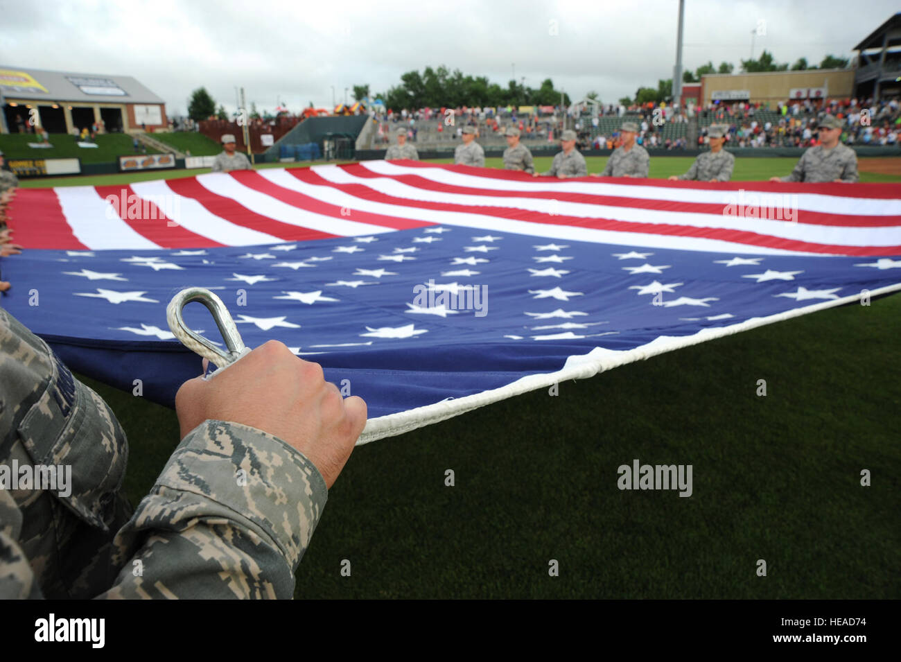A joint service team from Whiteman Air Force Base conducted a Flag Detail at the Kansas City T-Bones baseball game, - Stock Image