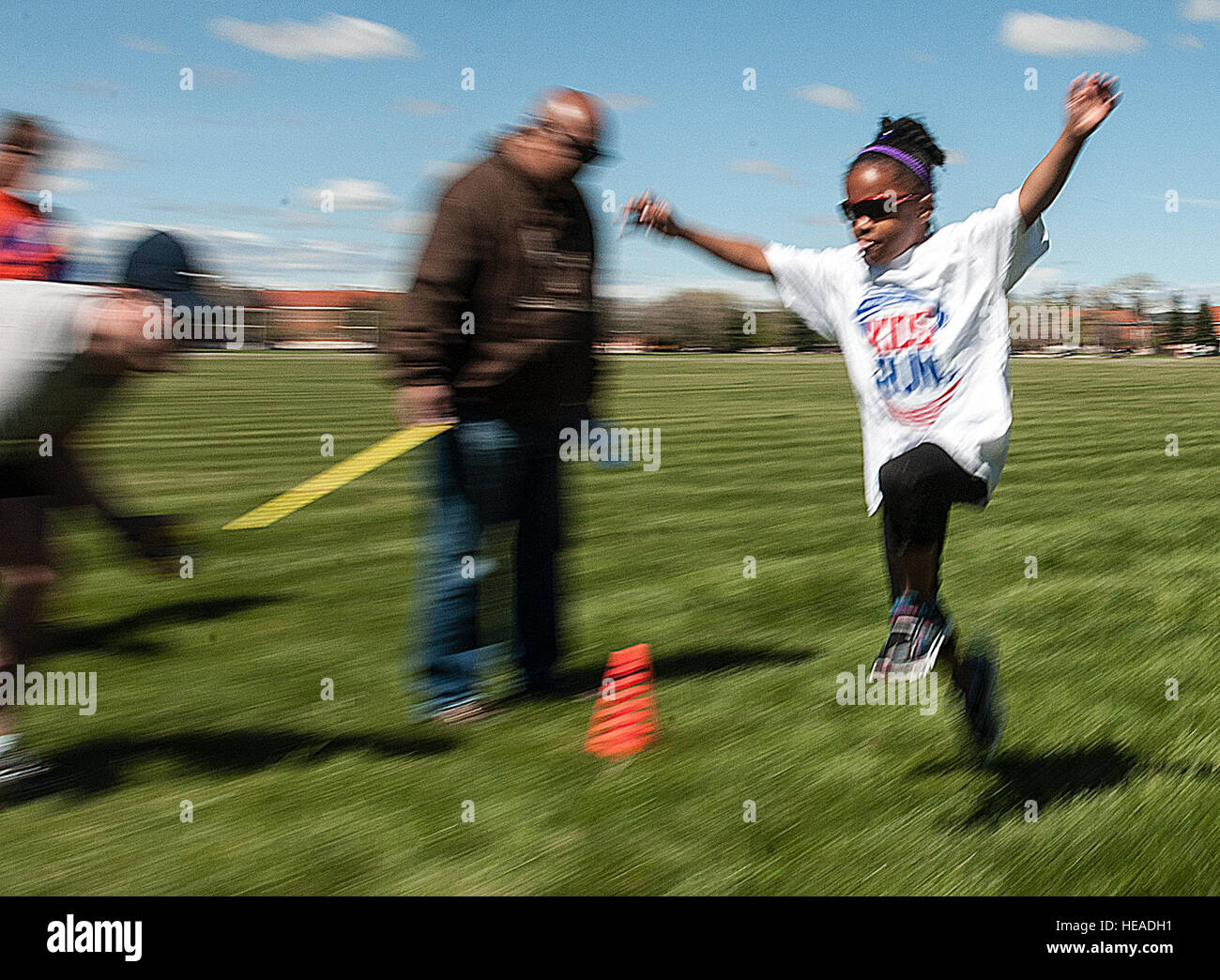 Joy Brisby, 6, leaps for distance during the long jump competition on the Argonne Parade Field on F.E. Warren Air - Stock Image