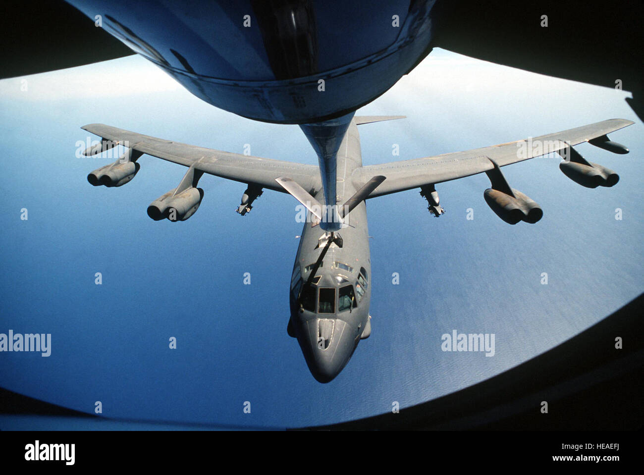A boom operator for a KC-135 Stratotanker refuels a B-52 Stratofortress during air operations for Operation Desert - Stock Image