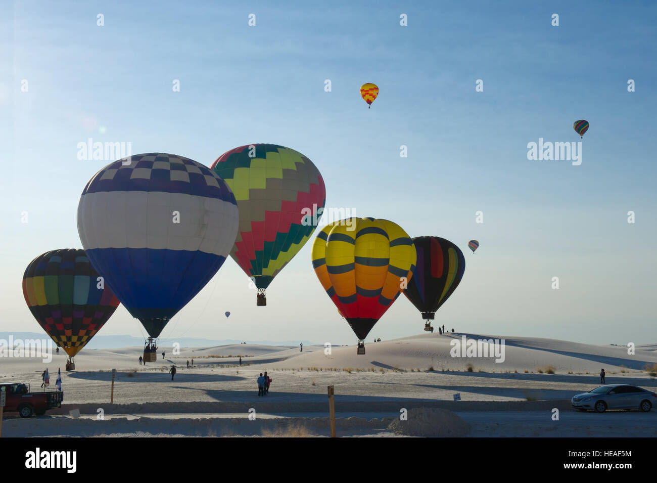Hot air balloons fly above the White Sands National Monument, N.M., during the 21st Annual White Sands Balloon Invitational Stock Photo