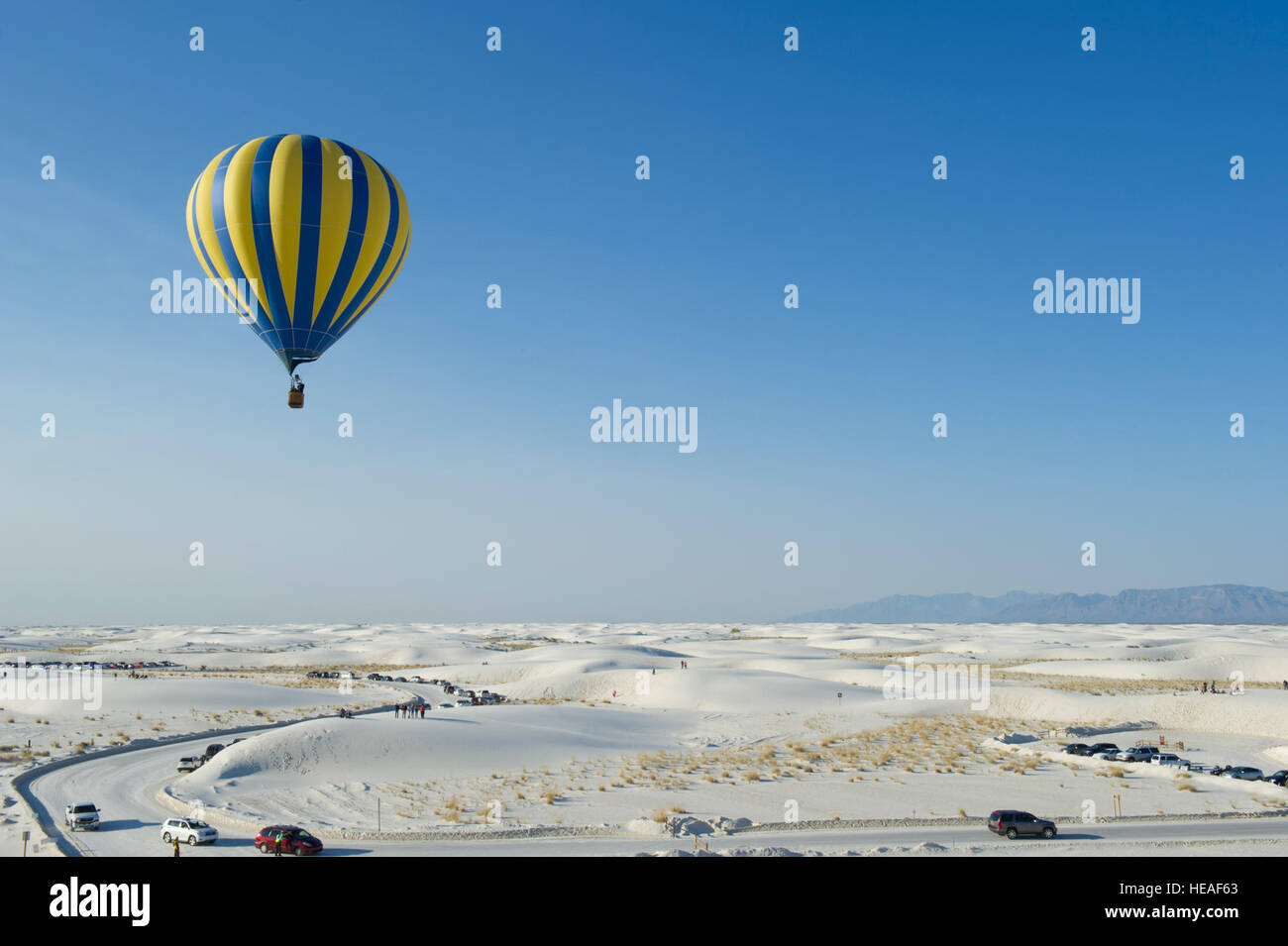 A hot-air balloon is piloted above the White Sands National Monument, N.M., during the 21st annual White Sands Balloon Stock Photo