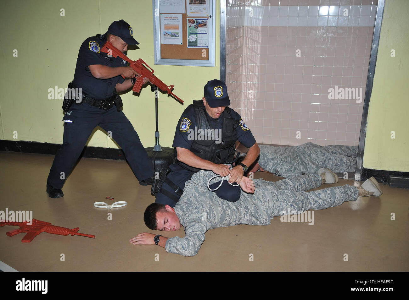 Members of the 87th Security Forces Squadron apprehend airmen posing as shooters during an active-shooter exercise - Stock Image
