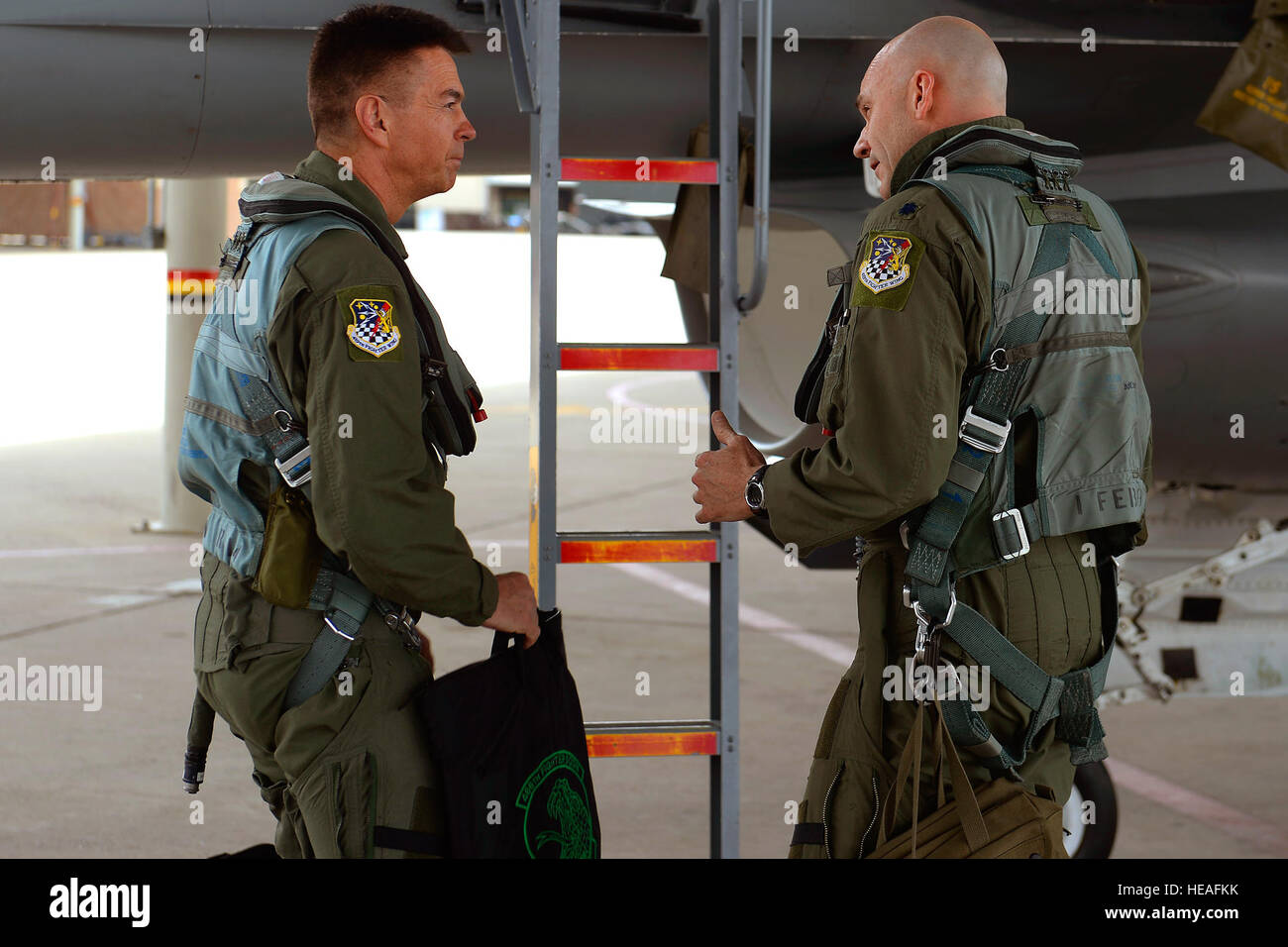 U.S. Air Force Lt. Col. Christopher Robinson (right), 419th Fighter Wing, briefs Maj. Gen. Jefferson S. Burton, - Stock Image