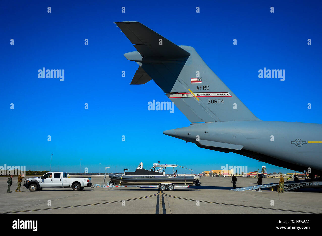 A Coast Guard 32-foot transportable port security boat is loaded into a C-17 Globemaster III at MacDill Air Force Stock Photo