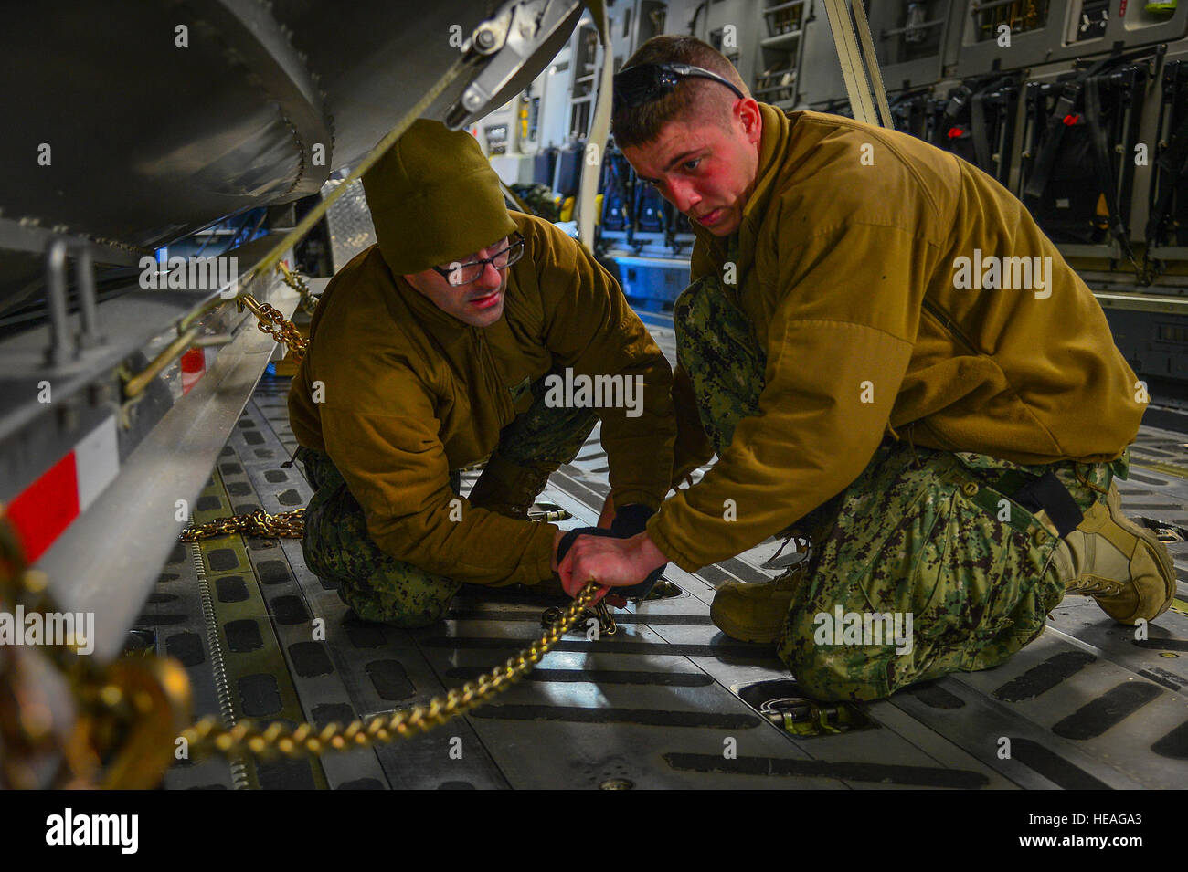 Petty Officer 2nd Class Matthew Farr (right), a machinery technician stationed at Port Security Unit 309 in Port Stock Photo