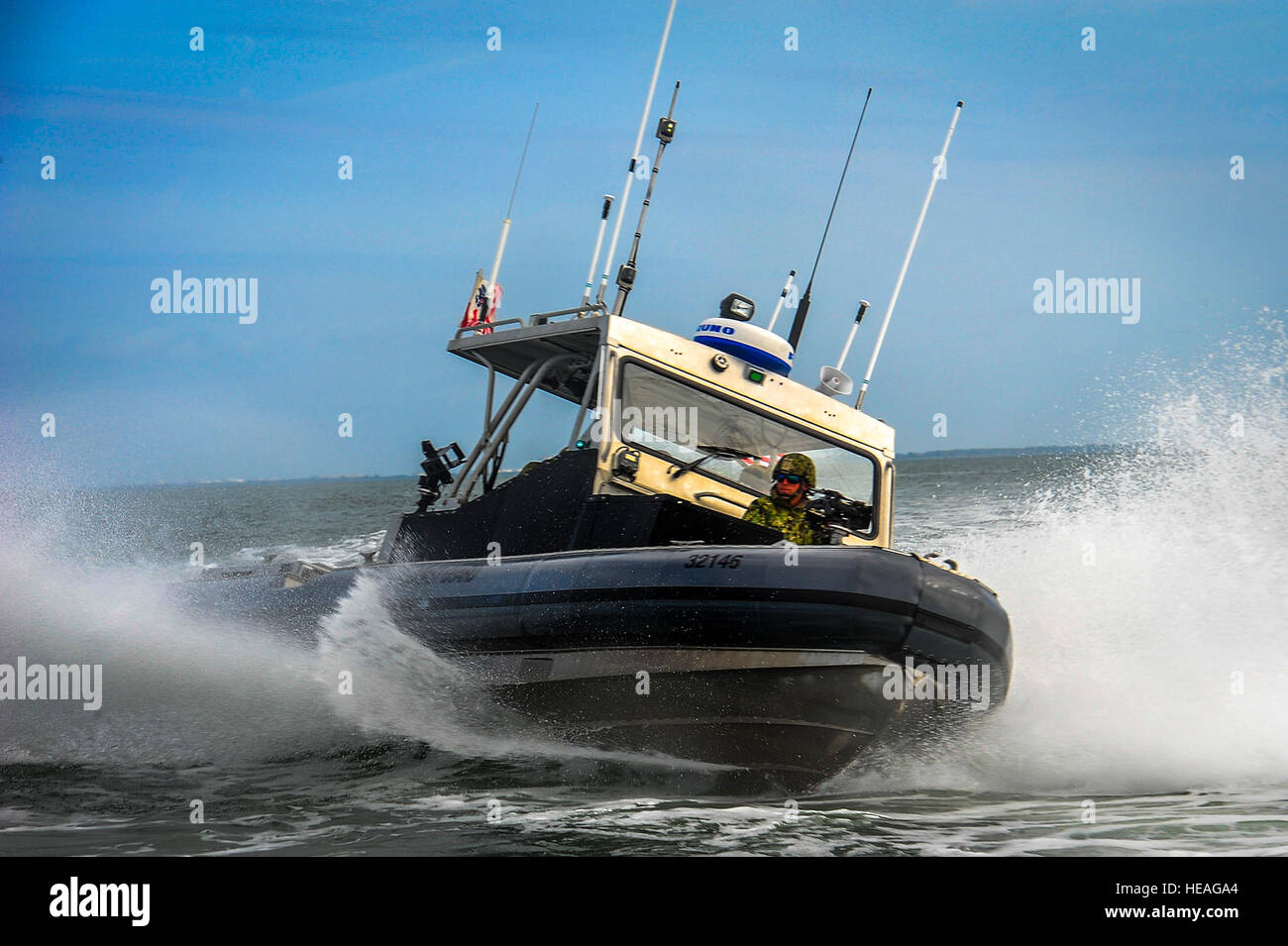 Members of the Port Security Unit 309 perform high-speed tactical boat maneuvers during a joint training exercise Stock Photo